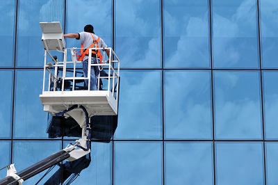 Window-Cleaner-on-Elevated-Work-Platform